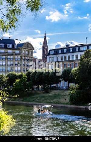 Strasbourg, Alsace, France, sightseeing tourists, small electric boat, river cruise, Ill river, residential buildings, cathedral's spire, - Stock Image