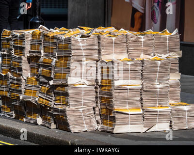 Evening Standard newspapers bundled for distribution in London - Stock Image