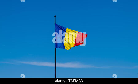 Romanian flag waving on a sunny summer day in Alba Iulia, Romania. - Stock Image