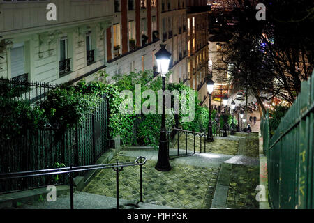 Paris, 18th district, Montmartre, staircase going up towards the basilica of Sacred Heart at night. - Stock Image