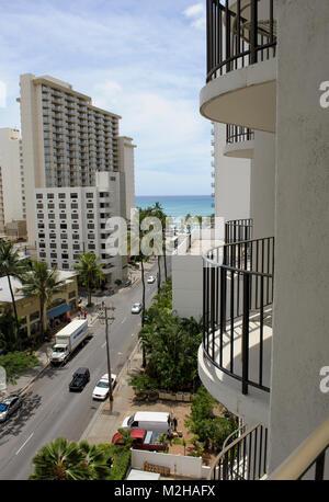 Glimpse of Waikiki Beach from high rise hotel balcony. Hawaii, USA - Stock Image