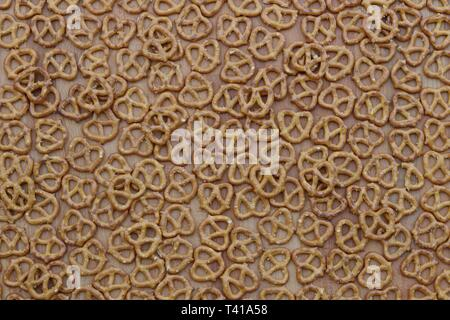 Still life of pretzels against a wooden background - Stock Image
