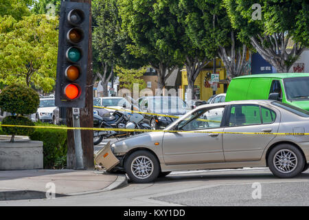 Traffic signal knocked off pole but still hanging and working. - Stock Image