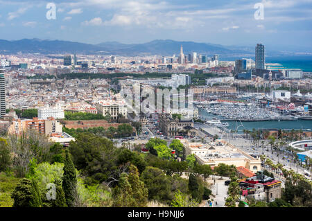 View of the city center, waterfront, and small boat harbor of Barcelona, Catalonia, Spain. - Stock Image
