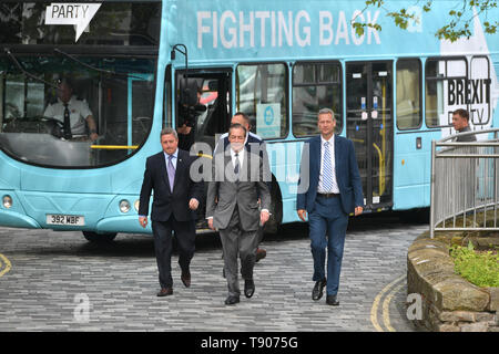 Brexit Party leader Nigel Farage arrives for a walkabout in Merthyr Tydfil, Wales. - Stock Image