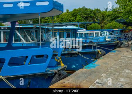Blue ferries on Villingili island, Male, Maldives - Stock Image