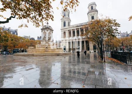 Paris (France) - Fountain Quatre Points Cardinaux and church of Saint-Sulpice - Stock Image