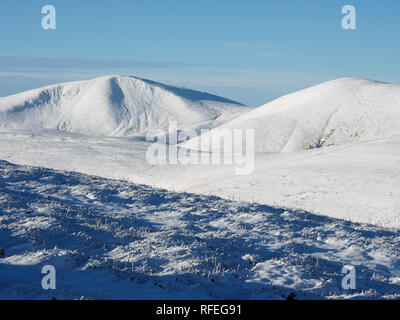 Snowy Southern Uplands from Worm hill, near Tweedsmuir, Scotland - Stock Image