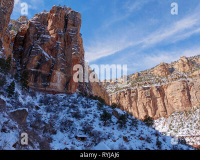The towering canyon walls on the Bright Angel Trail. When the sun hit one wall, the heat melted ice and chunks of ice and rock came down with an amazi - Stock Image
