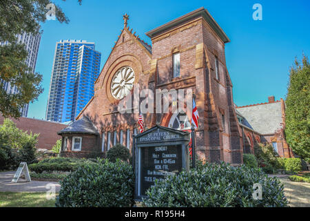 CHARLOTTE, NC, USA-10/30/18: St. Peter's Episcopal Church was completed in 1895, and now stands against a background of modern skyscrapers. - Stock Image