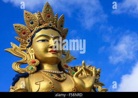 The head and shoulders of the Healing Tara Statue of Buddhism at Kagyu Samye Ling monastery, Scotland - Stock Image