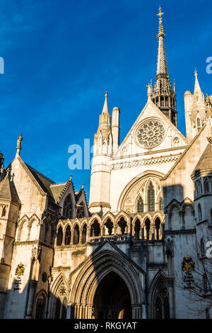 Morning sun over the main entrance and spire of the Royal Courts of Justice, The Strand, London, UK - Stock Image