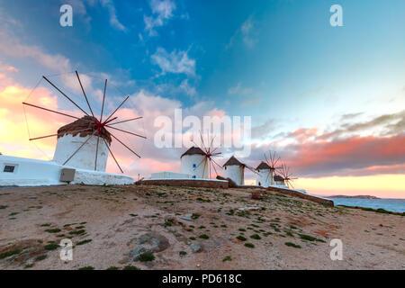 Traditional white windmills at sunrise, Mykonos, Greece - Stock Image