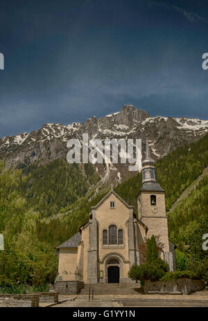 A church at the foot of the Alps in Chamonix, French Alps, France - Stock Image