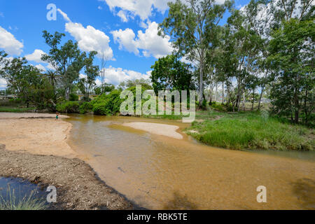 Natural mineral hot water flowing in Nettle Creek, Innot Hot Springs, a popular destination, Atherton Tablelands, Far North Queensland, FNQ, QLD, Aust - Stock Image