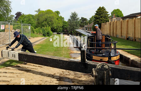 """The narrow boat """"Amy"""" is starting to descend down lock 11 on the Marple flight of locks after the canal was reopened following extensive repairs. - Stock Image"""