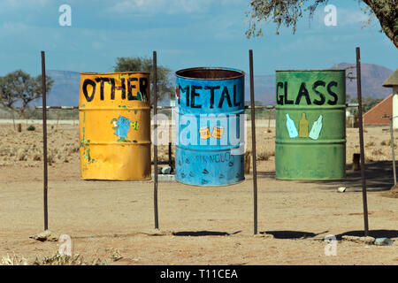 Recycling bins outside a lodge at Sossusvlei, inside the Namib-Naukluft Park in Namibia. - Stock Image