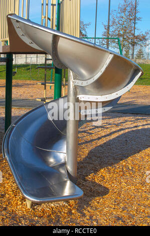 A metal spiral slide part of some playground apparatus from a children`s play area in a local park in Pitt Meadows, British Columbia, Canada. - Stock Image