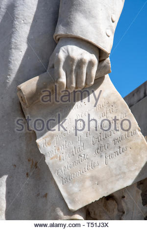 White marble monument honoring Miguel Jeronimo Gutierrez in the 'La Pastora' park. His hand holds a piece of paper with text. He was a poet, journalis - Stock Image