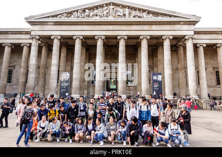 London England United Kingdom Great Britain Bloomsbury The British Museum human culture history exterior courtyard facade front entrance ionic column - Stock Image