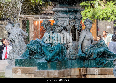 Bronze divinity statues in the Rossio Square's fountain, built in 1889 in Lisbon, Portugal - Stock Image