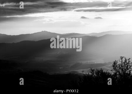Sunrays coming over a valley in Umbria (Italy) - Stock Image