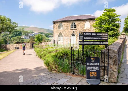 Visitor at entrance to the Blaenavon World Heritage Visitor Centre, Blaenavon, Gwent, Wales, GB, UK - Stock Image