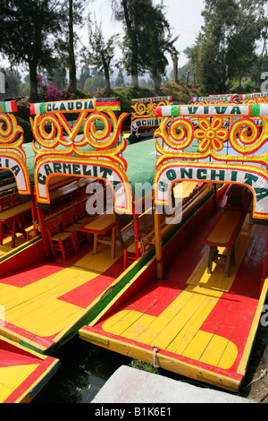 Colourful Trajinera Boats on the Canals of the Floating Gardens of Xochimilco, Mexico City - Stock Image