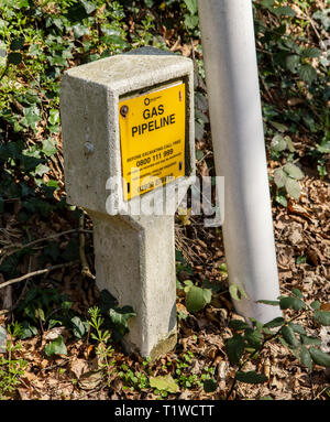 Gas pipeline sign by the roadside, Trow Hill, Sidmouth, Devon, UK - Stock Image