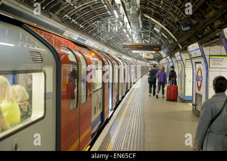 Train about to depart from a station on the Victoria Line of London's Underground, otherwise known as The Tube. - Stock Image