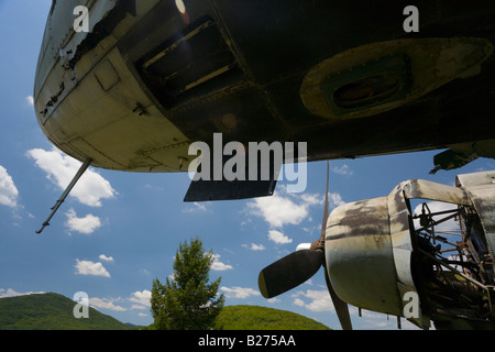Derelict aircraft, C-47 Skytrain of ex JRV in Otocac, Croatia, missing panels behind engine - Stock Image