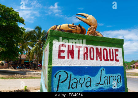 Playa Larga sign in the village of Caleton showing an image of a land crab which inhabit the area.  Bahia de Cochinos, Cuba, Caribbean - Stock Image