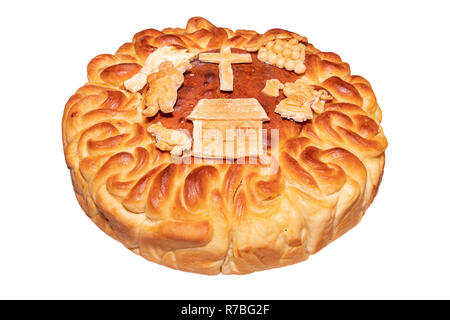 homemade bread korovai for holidays and weddings on the table among the Slavic peoples on a white background - Stock Image