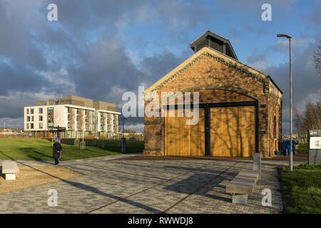 A view across Waterside Campus, home to the University of Northampton, UK; restored Engine Shed, home to the Student Union in the foreground. - Stock Image