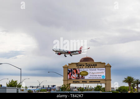 Airplanes landing at McCarran airport in Las Vegas Nevada at a very low altitude over the Town Square shopping mall - Stock Image