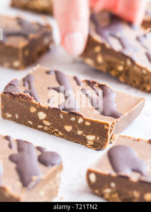 Homemade protein no sugar bars with peanut butter and hemp protein (vegan). - Stock Image
