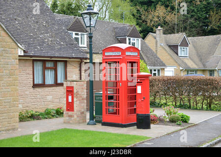 Collection of communication artefacts in a garden in the north Oxfordshire village of Hook Norton comprising, K9 - Stock Image