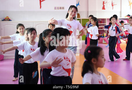 Fuzhou, China's Jiangxi Province. 24th Apr, 2019. Students of Shuibei Xinqu Primary School practise Yihuang Opera under the guidance of a teacher in Yihuang County of Fuzhou City, east China's Jiangxi Province, April 24, 2019. Yihuang County brings Yihuang Opera to school by establishing Yihuang Opera class and promoting Yihuang Opera aerobics. Yihuang Opera was enlisted in the first batch of national intangible cultural heritages in 2006. Credit: Wan Xiang/Xinhua/Alamy Live News - Stock Image