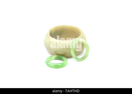 Jade bracelets on isolated white background - Stock Image