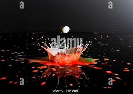 Liquid Art, the study of a liquid drop creating shapes from fluid dynamics - Stock Image