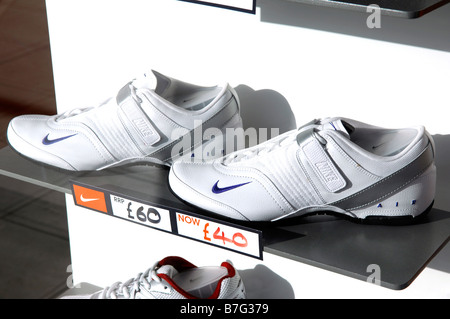 nike footwear trainers training shoes window display reduced american company fashion retail shop store niketown - Stock Image