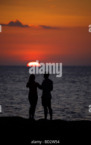 Young lovers enjoying the sunset over Holbox Island, Quintana Roo, Yucatán Peninsula, Mexico, a unique Mexican - Stock Image