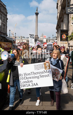 The London March Against Trophy Hunting and Extinction gathered at Cavendish Square and marched through Central London to Downing Street. - Stock Image
