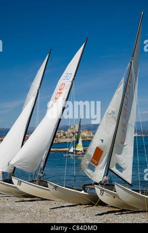 Antibes, French Riviera, beach and catamarans - Stock Image