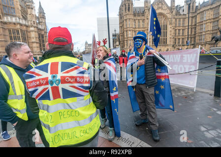 London, UK. 19th December 2018. A small group of extreme right-wing pro-Brexit protesters shout insults at the daily SODEM (Stand of Defiance European Movement) protesters and to shout personal insults at Steven Bray who founded SODEM in September 2017. Police tried hard to keep the clashes peaceful, and warned the right-wing protesters about their language. The Brexiteers then accused the police of taking sides. Eventually they moved away to protest outside parliament. Peter Marshall/Alamy Live News - Stock Image