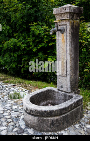 A source of potable water on a stone pavement - Stock Image