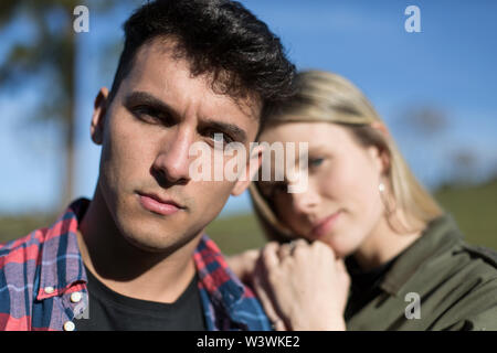 Man and woman in the sun with shirt to box and jeans jacket - Stock Image