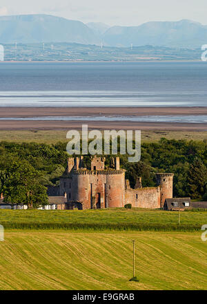 Caerlaverock Castle shown within the surrounding landscape giving its position next to the Solway Firth in Dumfries - Stock Image
