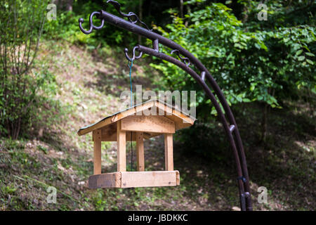 A small wooden birdhouse - Stock Image