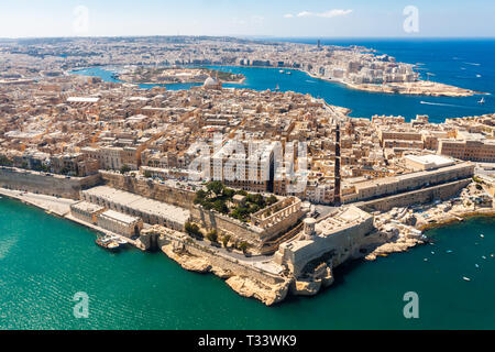 Historical Valetta, capital city of Malta, Grand harbour, Gzira and Sliema towns, Manoel Island in Marsamxett bay from above. Skyscraper in Paceville  - Stock Image
